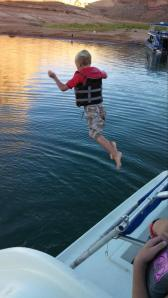Ace jumping off the back of the house boat. By the end of the week, he got confident enough in his swimming, that he did it w/o his life jacket ... with Adam or I waiting at the bottom :)