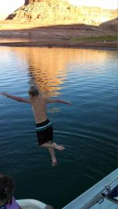 Anderson jumping off the back of the houseboat. He was such a big kid this year!