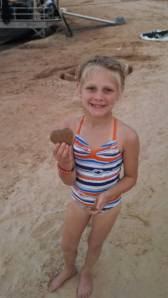 She had a good time making sand shapes.