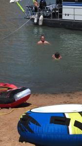 Uncle, David teaching swim lessons.
